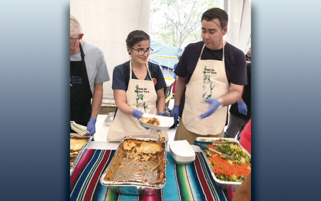 Rabbi Sirbu and a colleague work on the food from the World Central Kitchen that they'll serve in Matamoros. (All photos courtesy Steven Sirbu)