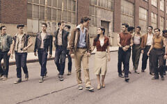 "Ansel Elgort walks hand-in-hand with Rachel Zegler as other cast members follow in the new movie version of ""West Side Story."" Some of the filming was done in Paterson."