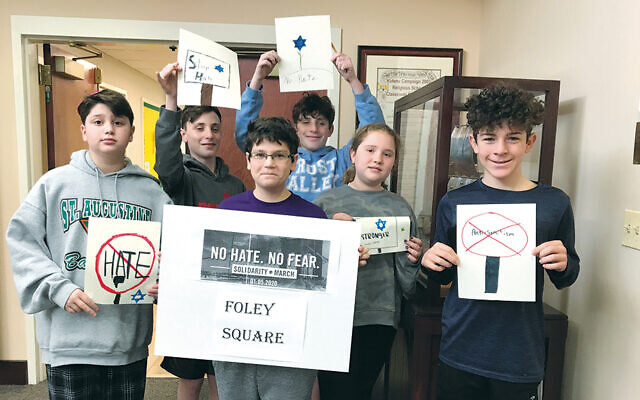 Kulanu kids prep for anti-hate rally.