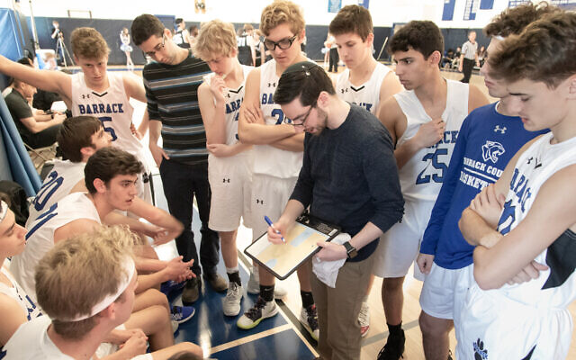 Coach Ben Falk provides instruction to his Barrack Hebrew Academy basketball team. (Jay Gorodetzer Photography)