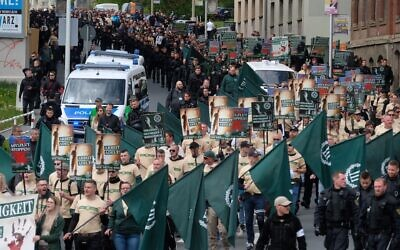 Far-right and neo-Nazi supporters walk through Plauen in eastern Germany, May 1, 2019. (Sebastian Willnow/DPA/AFP via Getty Images)