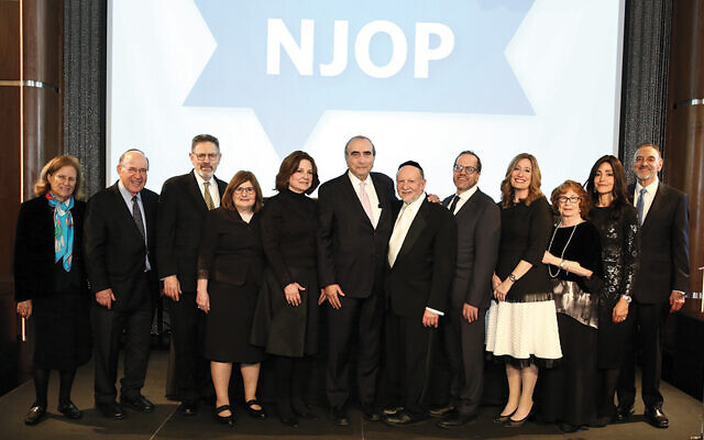 Among the celebrants, pictured from left, were Diane and the Honorable Robert Abrams, Robert and Dr. Susan Chambré, Felise and Hillel Gross, NJOP founder and director Rabbi Ephraim Z. Buchwald, Dr. Gabriel and Anat Levi, Helga Weisburger, and Yona and Dr. Steven Lazar. (Courtesy NJOP)
