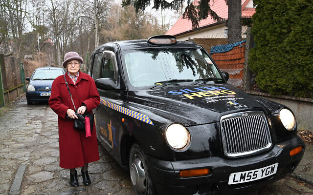 Anna Stupnicka-Bando, the 90-year-old president of the Polish Association of the Righteous Among the Nations, gets set to enter one of the taxis for saviors of Jews, in Warsaw, Poland, Jan. 29, 2020. (Cnaan Liphshiz)