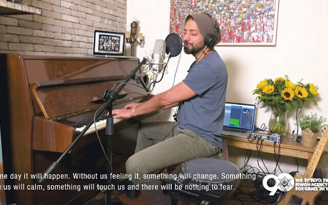 Idan Raichel sings from his home as about 400,000 people around the world watch from theirs. (JNF)