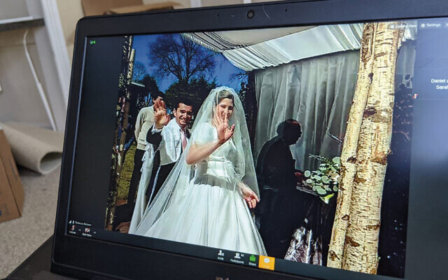 A virtual guest watches the wedding streaming online.