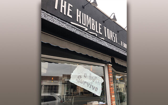 A sign of the times — this Teaneck restaurant looks forward with hope. (Jamie Janoff)