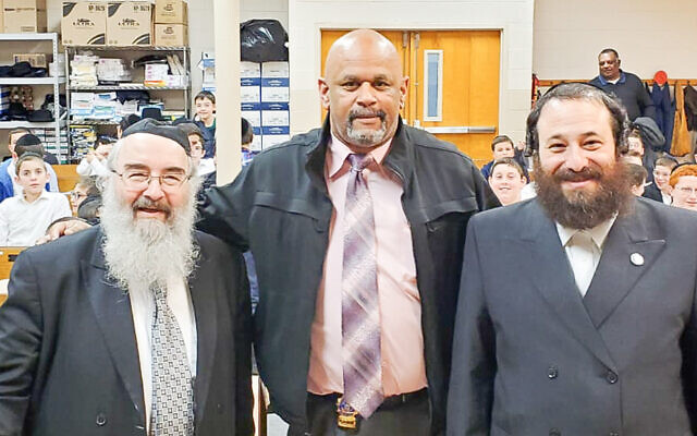 Rabbi Moshe Schwab, left, with Spring Valley Police detective Reginald Anderson and Rockland County legislator Aron Wieder (Photo provided)