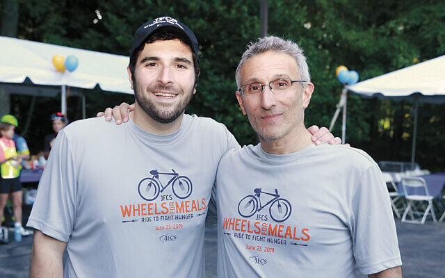 David Feuerstein and his father, Robert, at last year's ride. David was 15 when he came up with the bike ride as a JFCS fundraiser. (Photos courtesy JFCS)
