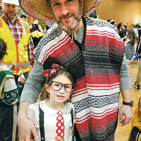 More than 200 people enjoyed a Purim party in Hackensack, co-hosted by Friends of Lubavitch of Bergen County and Chabad of Hackensack. The program included a Megillah reading and live music and a show by award-winning mentalist Marc Garfinkel.(Photo provided)