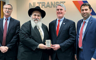 From left, Paul Wyckoff, Rabbi Mordechai Kanelsky of Bris Avrohom, NJTransit executive director Kevin Corbett, and NJTransit senior vice president, Justin Davis. (Courtesy Bris Avrohom)