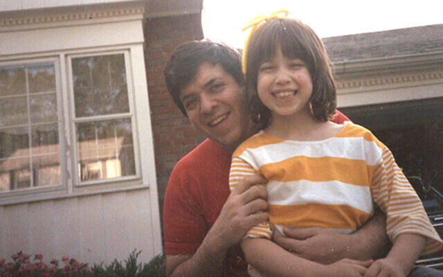 Tony Glickman holds his young daughter, Dalia.