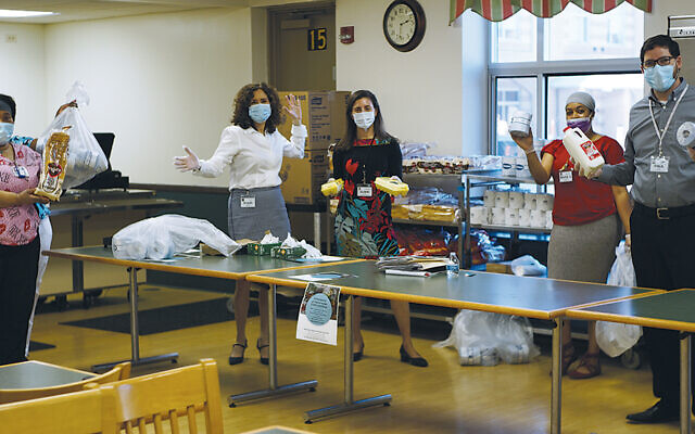 Jewish Home employees shop at work. (Jewish Home Family)