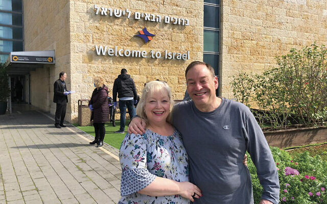 Ed and Barbara Susman from Teaneck beam as they land in Israel; they're thrilled to make aliyah even though they'll have to undergo a 14-day self-quarantine. (Nefesh b'Nefesh)