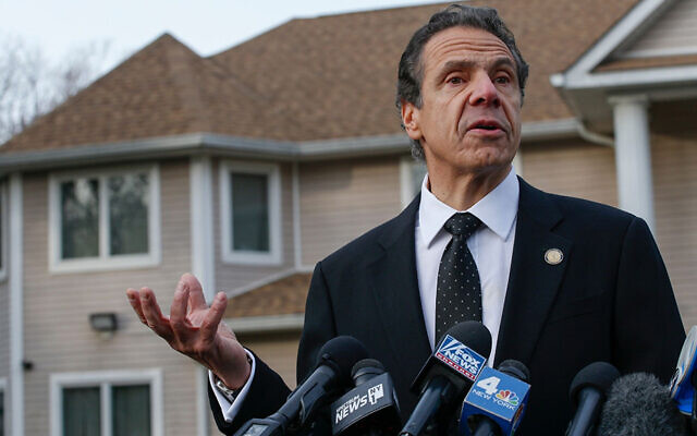 Andrew Cuomo talks to reporters outside Rabbi Chaim Rottenberg's house in Monsey on December 29, 2019. (Kena Betancur/AFP via Getty Images)