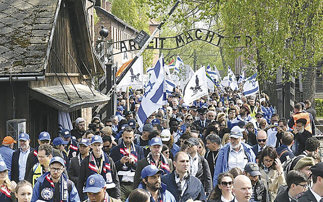 Participants of the March of the Living exit a gate in Auschwitz, Poland, on May 2, 2019.
