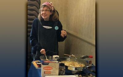 Esther Spiegel prepares her matzah brei