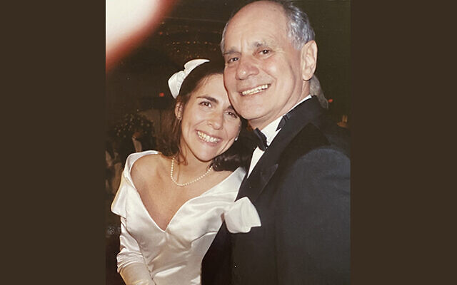 Stacey Springer Goldberg and her father, Leonard Springer, take a moment together at Stacey's wedding, many years ago.