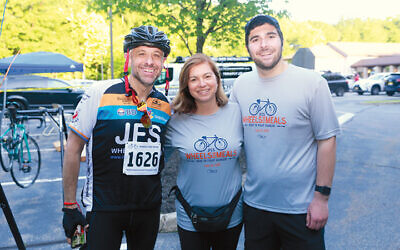 JFCS bike ride committee member Alan Yung, left, stands with with JFCS's immediate past president, Shira Feuerstein, and her son, ride founder David Feuerstein.