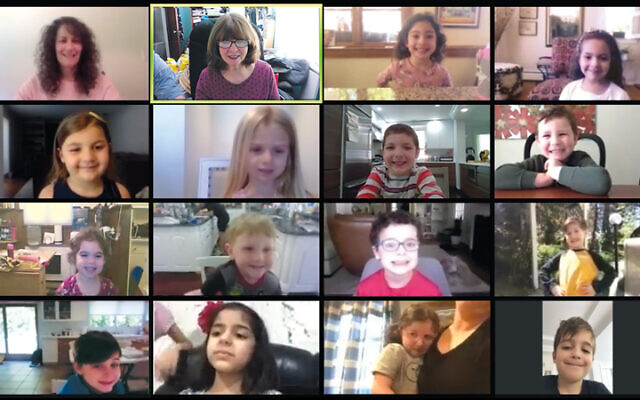 Siana Sadarangani, in the bottom row, joins the rest of her early childhood class from Temple Sinai on Zoom.