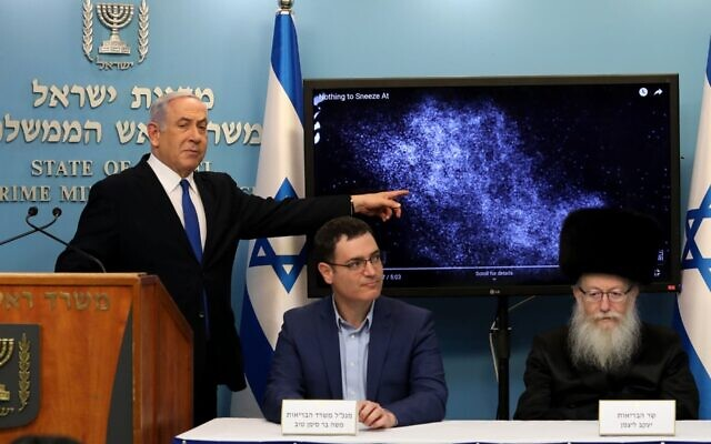Health Ministry General-Director Moshe Bar-Siman-Tov, center, flanked by Prime Minister Benjamin Netanyahu and Health Minister Yaakov Litzman, at a news conference about nationa; coronavirus measures at the Prime Minister's Office in Jerusalem on March 11, 2020. (Flash90)