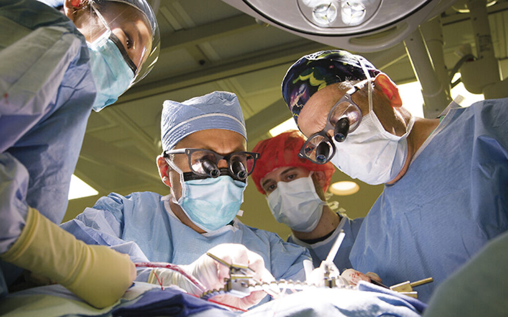 Dr. Herbert Dardik, right, leads of team working to fix an aneurysm at Englewood Health. (ENGLEWOOD HEALTH)