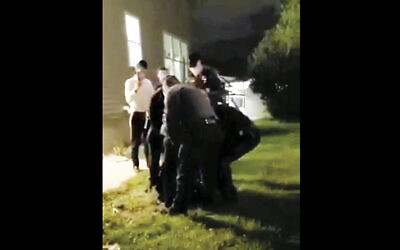 Rabbi Yisrael Knopfler being arrested in Lakewood. (FAA/Facebook)