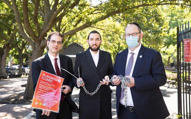 From left, City Councilman Kalman Yeger, New York State Assemblyman Simcha Eichenstein and State Sen. Simcha Felder open up Kolbert Playground in Brooklyn, June 16, 2020. (Benjamin Kanter)