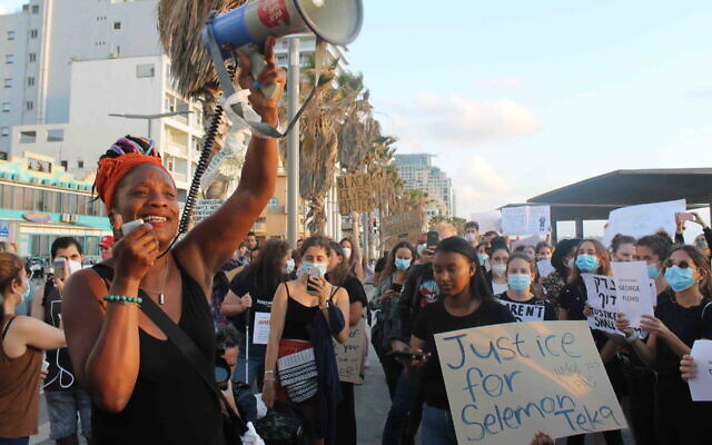 Chaya Lev addresses the crowd at a protest in Tel Aviv against the killing of George Floyd, June 2, 2020. (Sam Sokol)