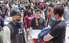 Mayor Steve Fulop, right, talks to a protestor at Berry Lane Park in Jersey City. (Jennifer Brown/City of Jersey City)