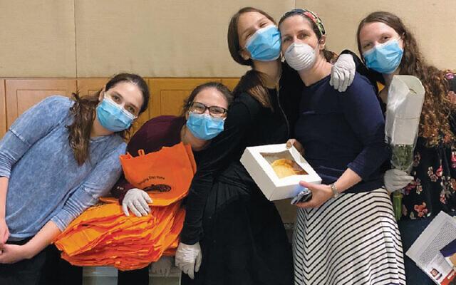 The Sklar family of Teaneck volunteered to pack bags for Shavuot. (Dalia Stelzer)
