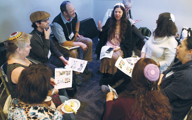 Rabbi Jill Hammer, center, teaches at AJR's annual retreat; this photo is from last year, when such gatherings were possible. (ACADEMY FOR JEWISH RELIGION)