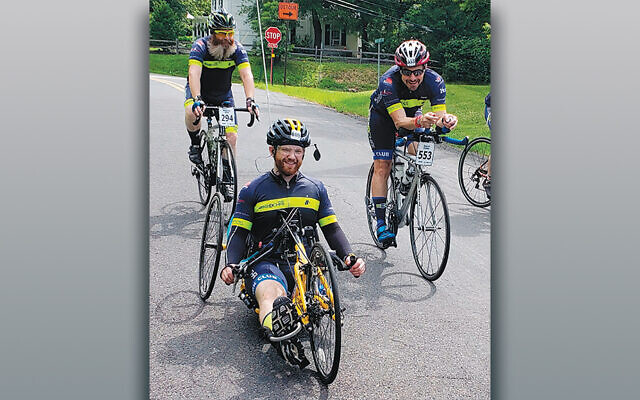 David Roher, JJ Eizik, and Nasanel Gold ride in Bike4Chai in 2018. (Bike4Chai)