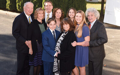 The whole family gathers at a happier time; top, from left, Marty and Bobbie Goldstein, Jason Weinger, Jill Goldstein, and Mikala, Tamar, and Jerry Weinger. Eli and Eileen Weinger are in front. (Bobbie Goldstein)