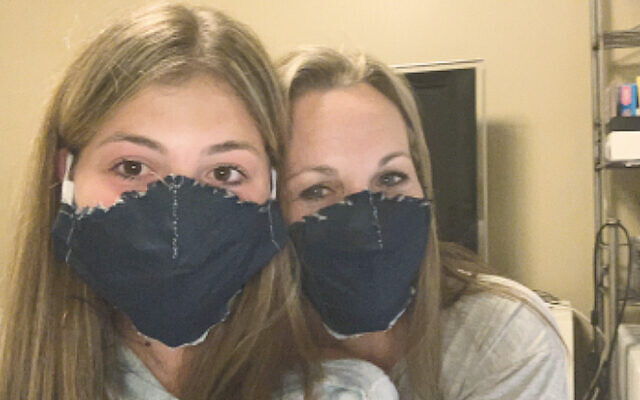 Staci Klonsky, co-president of TEPV's sisterhood, right, and her daughter Carly model the denim masks they made. (Courtesy TEPV)
