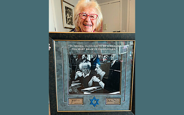 Dr. Ruth holds a picture of former Israeli prime ministers David Ben-Gurion and Golda Meir, whom she mentioned during her FIDF webinar. (Courtesy FIDF)