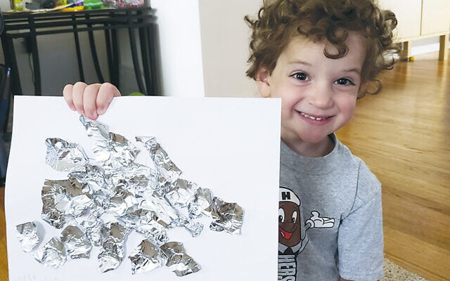 Max Gerber displays his art project.(Photos Courtesy Temple Emanuel of the Pascack Valley JCamp)