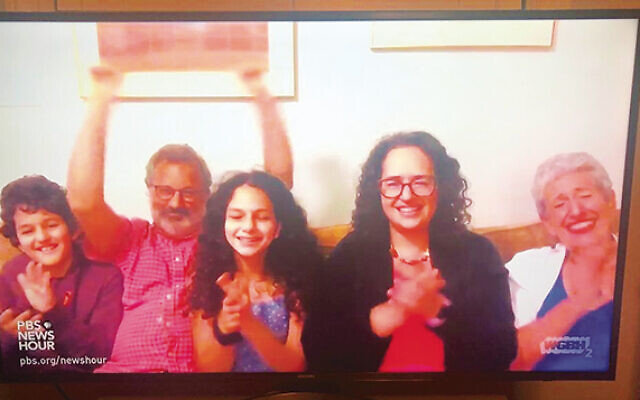 From left, Ziv Cohen-Margolius, Rabbi Marc Margolius, Galia Cohen-Margolius, Rabbi Ayelet Cohen, and Dr. Elaine Cohen applaud at the Democratic National Convention, from their couch in the Berkshires. Ziv's twin sister, Meital, is not in the photo although she also was onscreen. (Elaine Cohen)