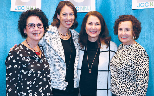 Erica Danziger, second from left, stands with committee members Susan Benkel, Amy Wexler, and Shari Friedberg, before the pandemic started.