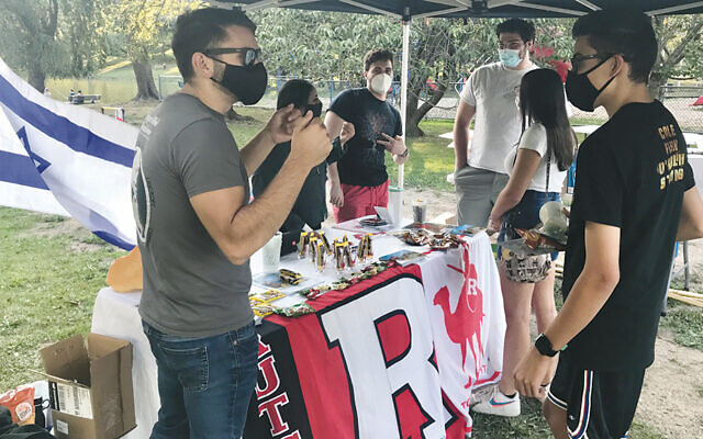 The meeting at Degnan Park in West Orange drew, from left, Rutgers Hillel staff members Ryan Siegel and Adva Solomon and students Julian Goodman of Florham Park, Sam Weiner of Rockaway, Dina Doctoroff of Livingston, and Yossi Tobin of West Orange. (Photos courtesy Rutgers Hillel)