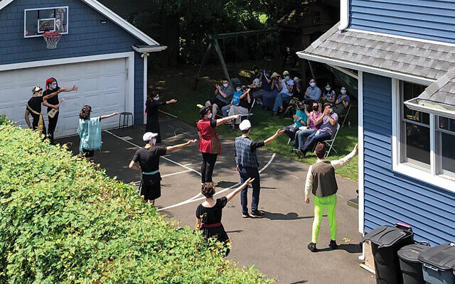 "This summer, socially distanced, masked students performed scenes from ""Twelfth Night"" for a similarly distanced and masked audience in Ms. Lopkin's backyard. (All photos courtesy Envision Theater)"