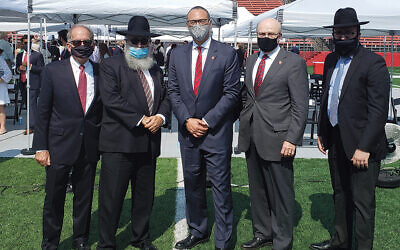 From left, Peter McDonough, senior vice president for external affairs at Rutgers University; Rabbi Yosef Carlebach, the executive director at the Chabad House there; Rutgers' President Dr. Jonathan Holloway; Dr. Christopher Molloy, the chancellor of Rutgers in New Brunswick; and Chabad House administrator Rabbi Mendy Carlebach. (Courtesy Chabad)