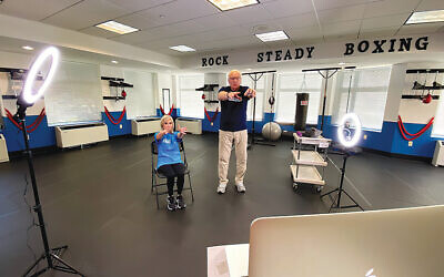 A JHF head coach and his wife run a virtual class from one of the JHF boxing gyms. (Photos courtesy JHF)