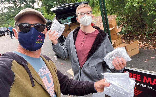 Chabad distribution coordinator Steve Hecht and volunteer Jordan Gold