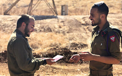 An IDF soldier receives a gift card last Rosh Hashanah. (Courtesy IDF)