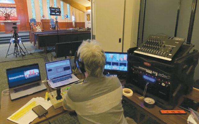Dave Steck, a technical director and cameraman at the studio console, looks into CBI's sanctuary. (Courtesy CBI)