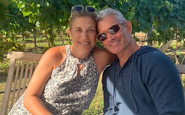 Cheryl and Lee Lasher sit together at a Long Island winery this summer.