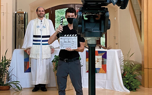 Rabbi Noah Fabricant of Kol Dorot and video professional — and Kol Dorot member — Dan Zambrano prepare a video segment for one of the shul's High Holy Day services. (Noah Fabricant)