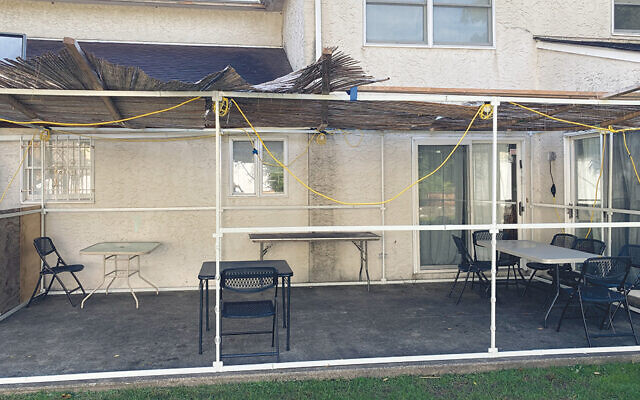 The sukkah at Rabbi Mischel's home is as open as possible, to allow as many people safely inside it as possible.