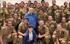 Moshe Avital is surrounded by Israeli soldiers, including his grandson Yair Slasky, behind and to Moshe's left. His grandson Eytan Slasky, a freshman at the Frisch School in Paramus, is in the front row.