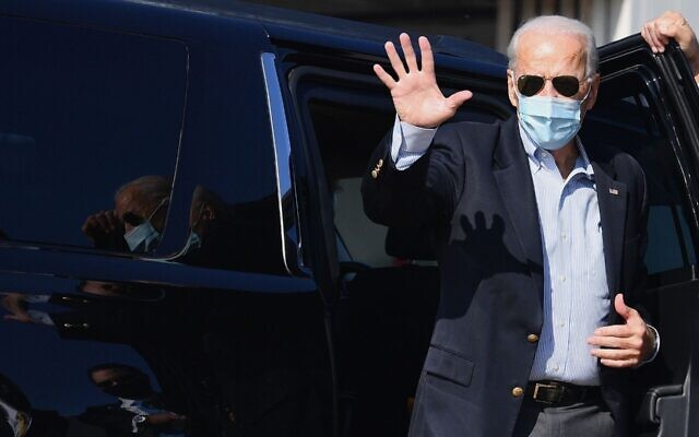 Democratic presidential candidate Joe Biden arrives to board his plane in New Castle, Dela., on Oct. 22, 2020. (Angela Weiss/AFP via Getty Images)